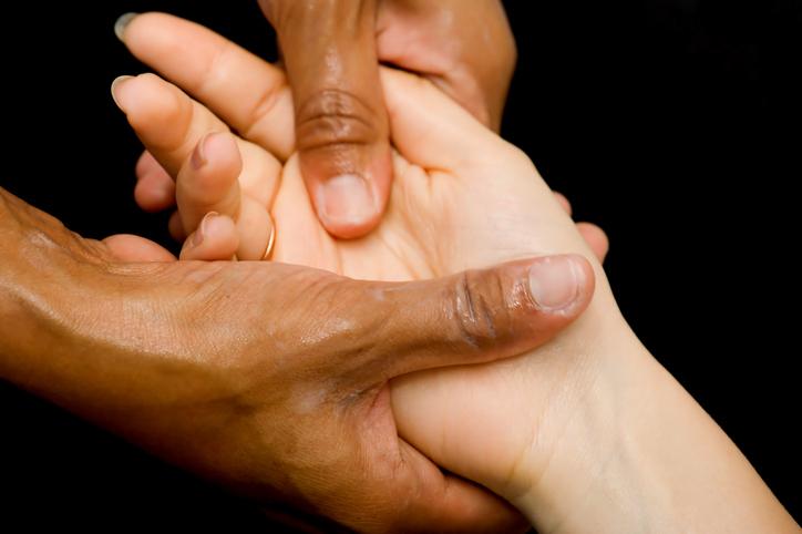 massaging acupressure point on hand