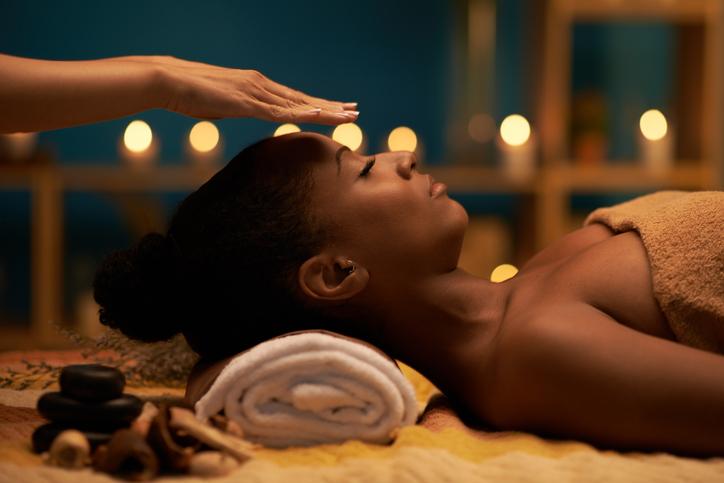person receiving reiki massage