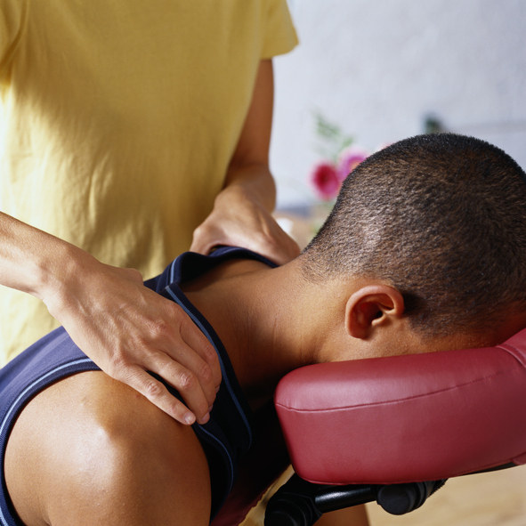 person receiving seated chair massage