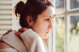 Sad woman gazing outside