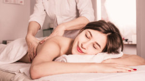 Young client enjoying relaxing massage in salon