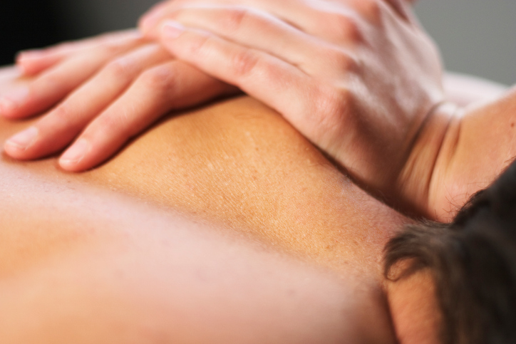 person receiving deep tissue massage