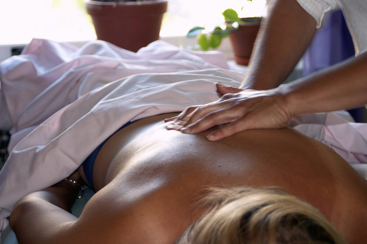 Woman having her back massaged.