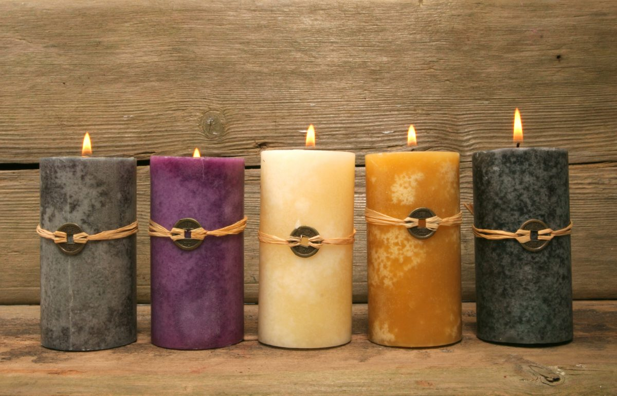 Five candles against wood background