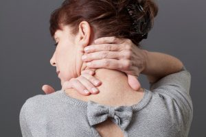 Woman trying to release shoulder tension