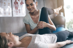 Shot of a physiotherapist treating a patient